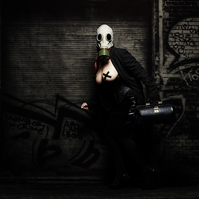 Girl with gas mask, and a doctor bag