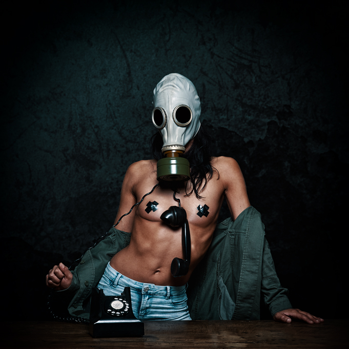 Girl with gas mask, and old phone
