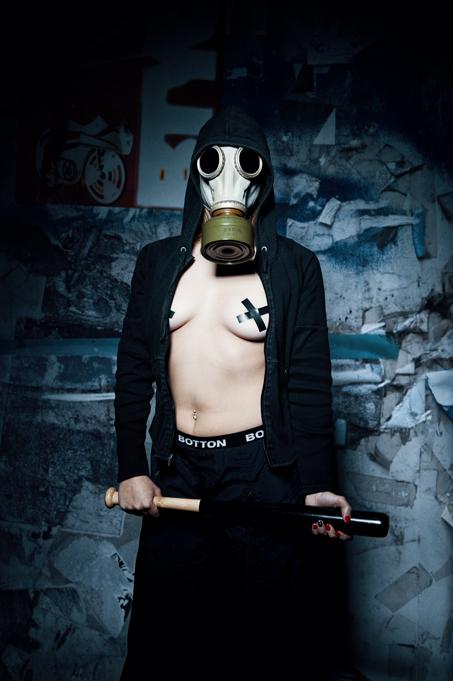 Girl with gas mask, holding a baseball bat