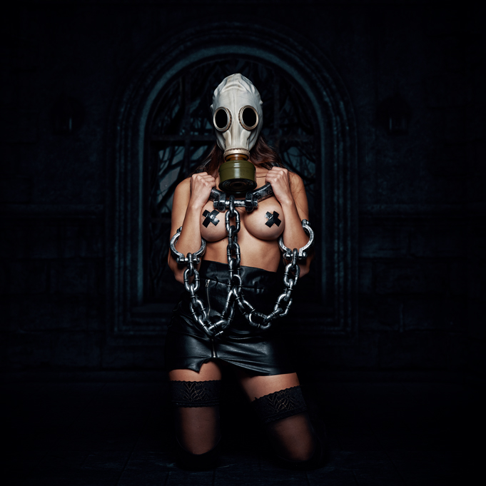 Girl in chains, with gas mask